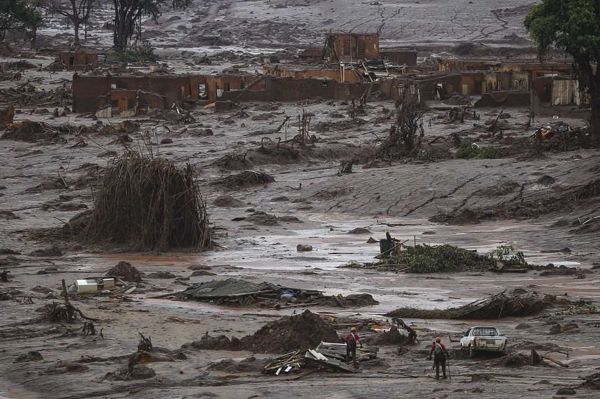 Firefighters search for victims in the mud in Bento Rodrigues in Mariana, Brazil  on Nov 5.