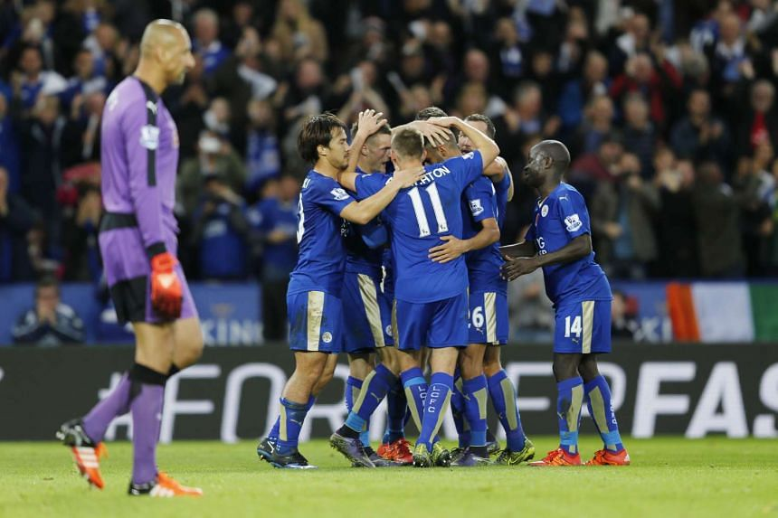 Jamie Vardy celebrates with team mates after scoring the second goal for Leicester from the penalty spot in the game against Watford.
