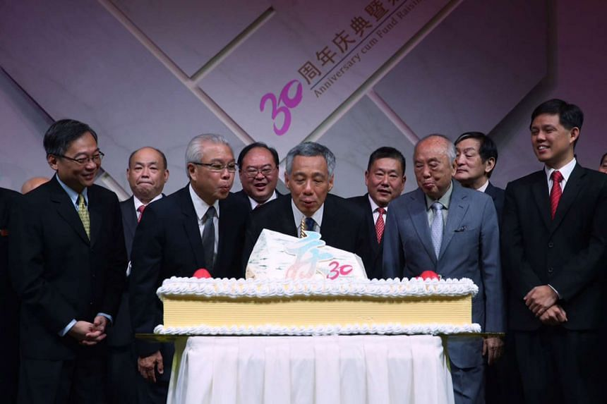 (Front row, from left) Health Minister Gan Kim Yong, SFCCA president Chua Thian Poh, PM Lee, SFCCA honorary chairman Wee Cho Yaw, Minister in the Prime Minister's Office Chan Chun Sing, (back row, from left) SFCCA property committee chairman Chan S