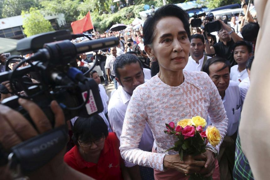 Myanmar's National League for Democracy party leader Aung San Suu Kyi arriving at her party headquarters after the general elections in Yangon on Nov 9, 2015.