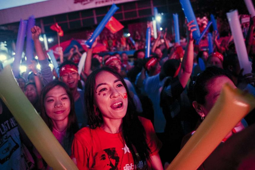 Supporters of opposition leader Aung San Suu Kyi celebrating outside the National League of Democracy headquarters in Yangon on Nov 9.