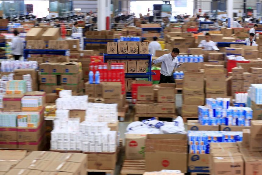 Employees working at a logistic centre in Suzhou in China's Jiangsu province.