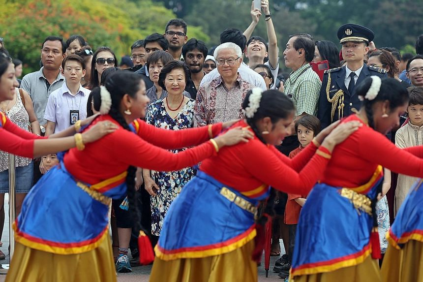 President Tony Tan Keng Yam and his wife, Mrs Mary Tan, watching an Indian dance performance by PAssionArts' Sembawang Silver Stars group at the Istana open house yesterday, in celebration of Deepavali.