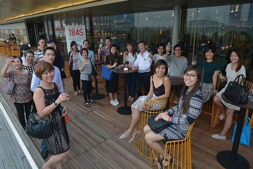 Ten lucky readers and their guests enjoyed a tour of the National Gallery Singapore and a dinner at Aura with Straits Times food critic Wong Ah Yoke (centre, in white shirt).