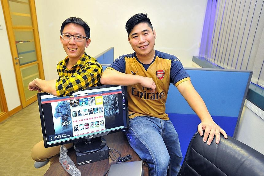 Mr Tan Chor Yong (left) and Mr Andrew Li are the people behind CDKeyplus.com. Newly released titles on the site are about 15 per cent to 20 per cent cheaper than elsewhere. Mr Tan promises the lowest price for CDKeyplus.com products, or he will refun