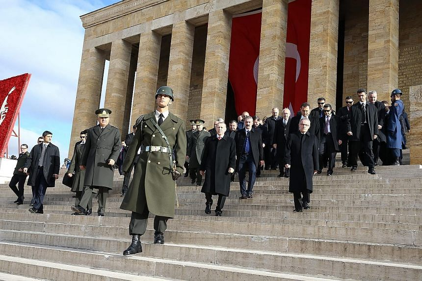 Turkish President Recep Tayyip Erdogan (centre) visiting the mausoleum of Mustafa Kemal Ataturk yesterday, the 77th death anniversary of modern Turkey's founding father.