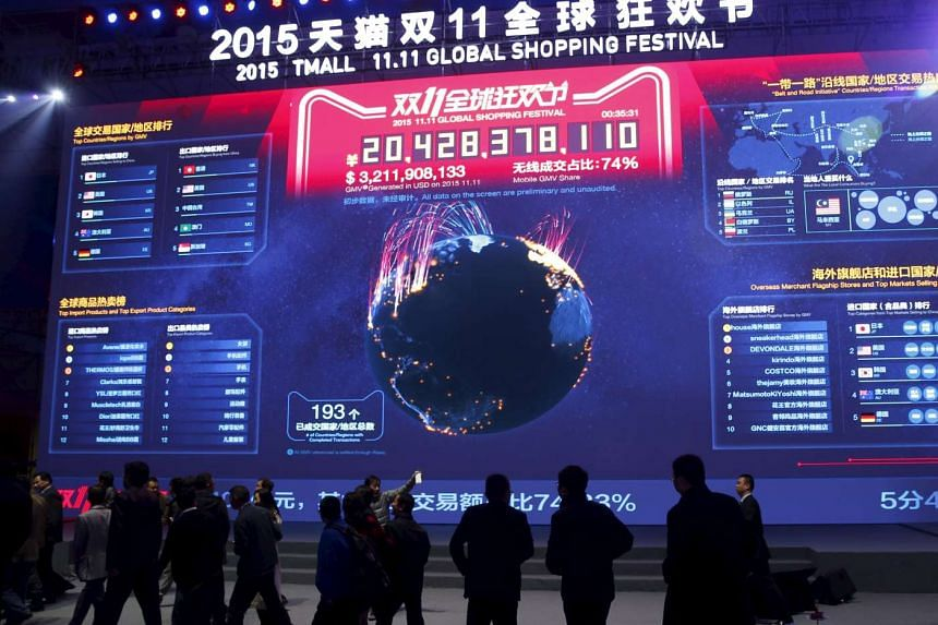 Attendants watching real-time data of transactions at Alibaba Group's 11.11 global shopping festival in Beijing on Nov 15, 2015.