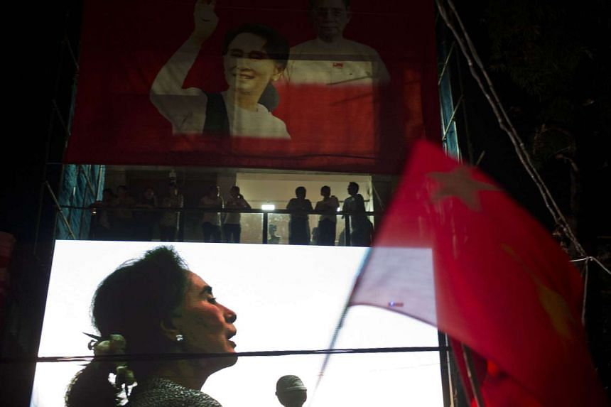 A huge portrait of Myanmar opposition leader Aung San Suu Kyi is displayed on the facade of the National League for Democracy headquarters in Yangon as supporters rally outside on Nov 9, 2015.