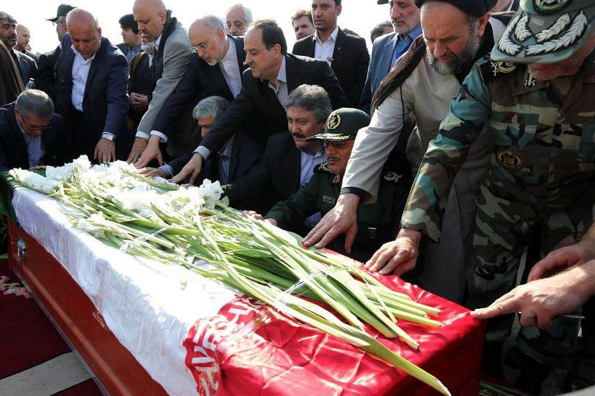 Iranian officials pray over the caskets of Iranian pilgrims killed in the stampede.