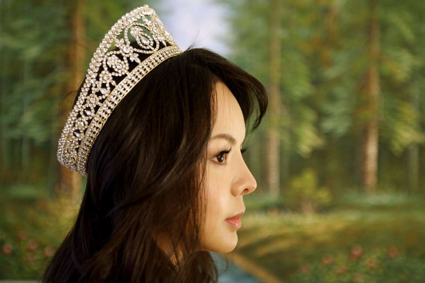 Canada's China-born Miss World contestant said on Tuesday (Nov 10) her visa to travel to the beauty pageant at a Chinese resort has been delayed.