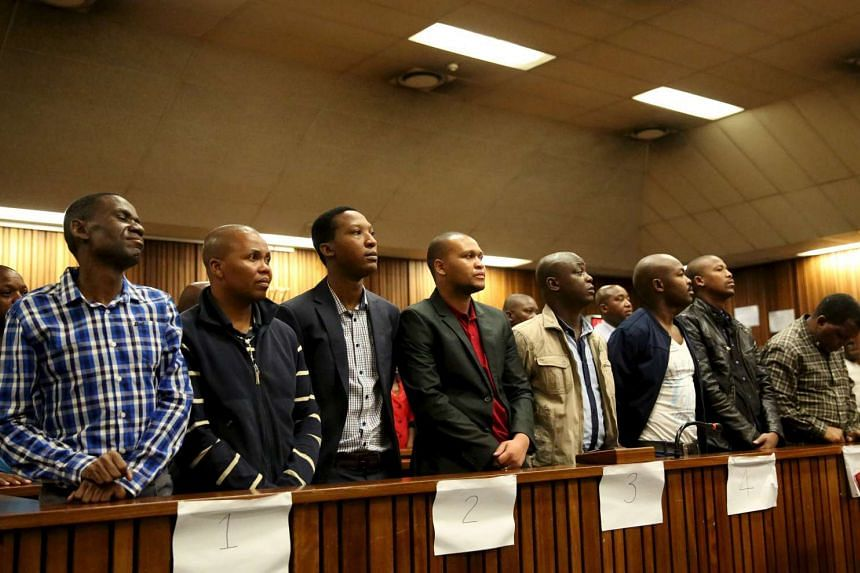 Former police officers wait to hear their sentencing in a court in Pretoria, South Africa, Nov 11, 2015.