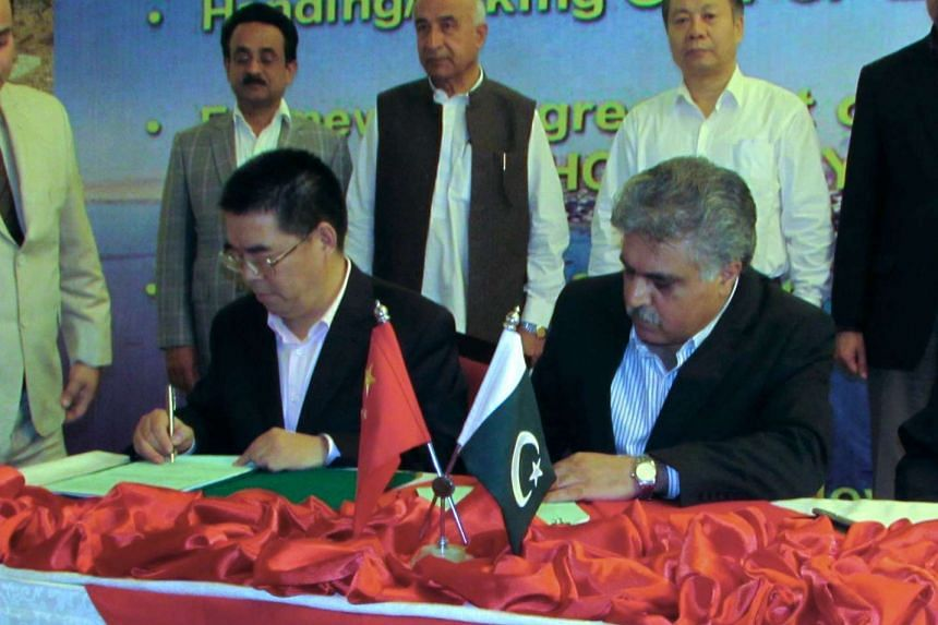 Officials of China and Pakistan at a signing ceremony in Gwadar.