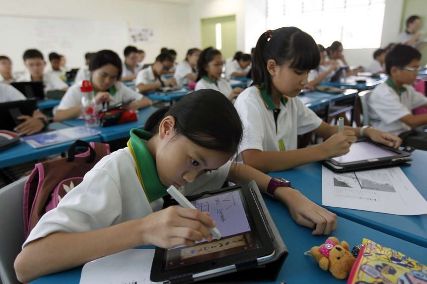 Tampines Secondary School students working on their schoolwork with the help of iPads.