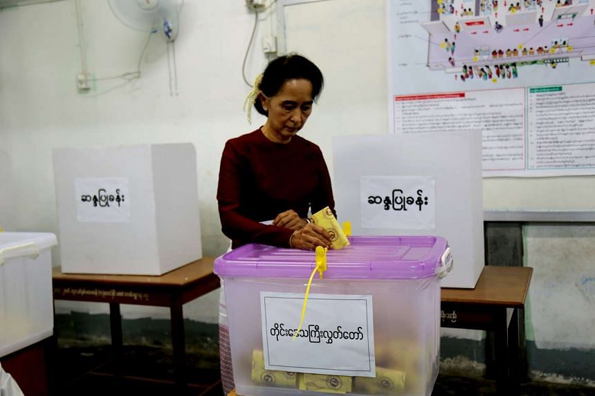 Ms Aung San Suu Kyi casts her ballot during the general election in Yangon on Nov 8.