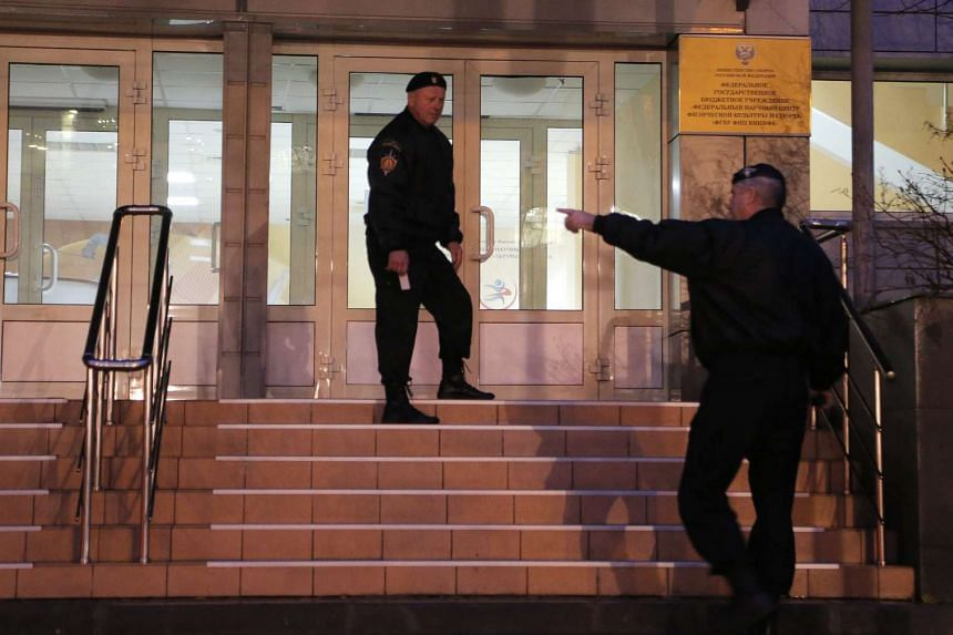 Security guards at the building where the Moscow Antidoping Centre and laboratory is located on Tuesday.