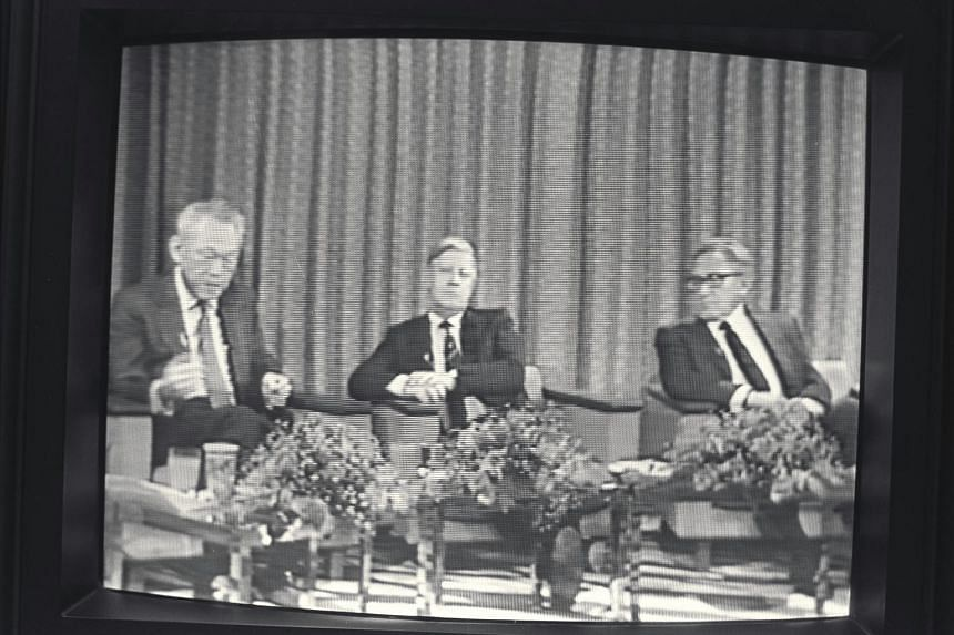 Prime Minister Lee Kuan Yew (left) discussing world economic problems with former West German Chancellor Helmut Schmidt (centre) and former American Secretary of State Henry Kissinger in Japan in 1983.