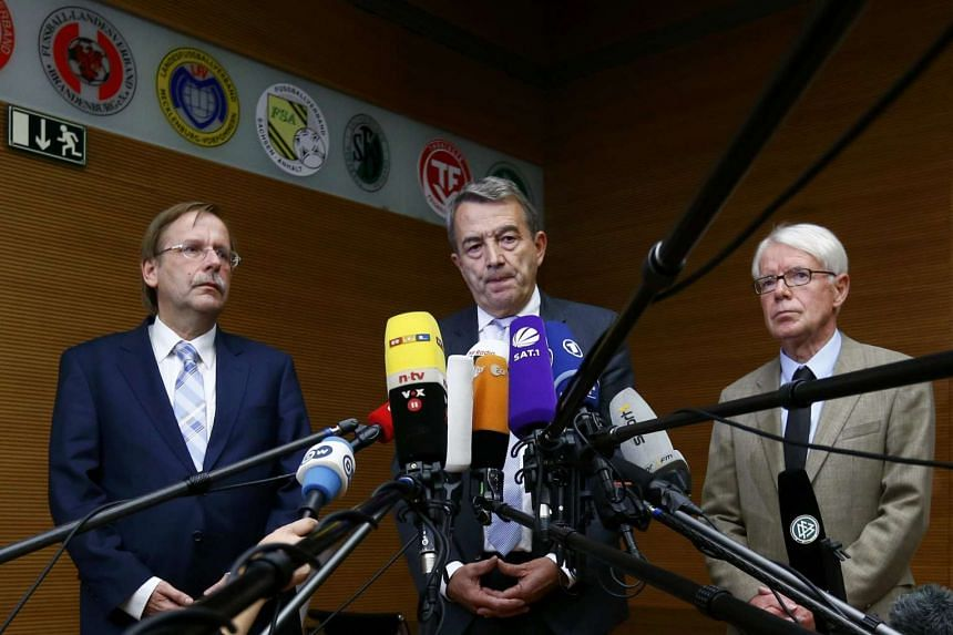 Wolfgang Niersbach (centre) giving a statement to the media at the DFB headquarters in Frankfurt, Germany on Nov 9, 2015.
