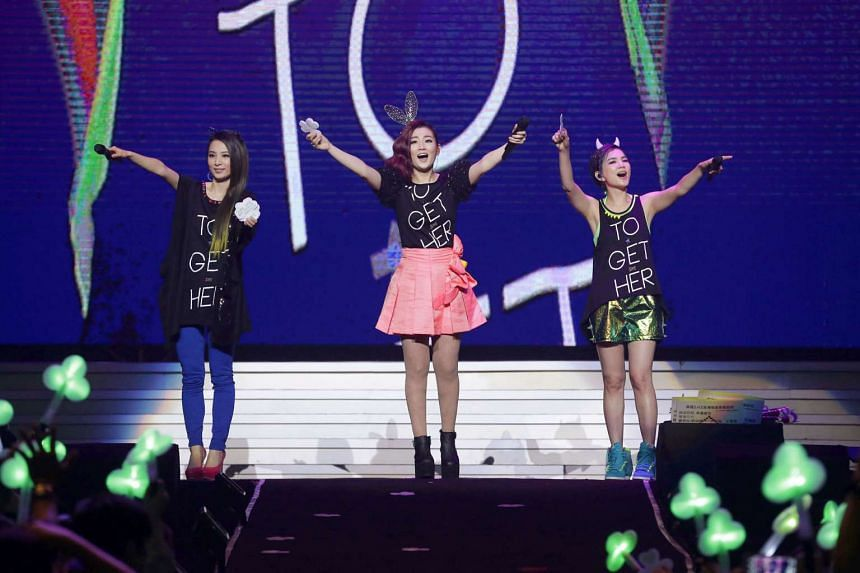 Taiwanese girl group S.H.E members (from left) Hebe Tien, Selina Jen and Ella Chen at a 2014 concert in Kaohsiung.