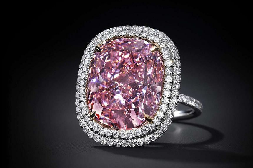 """The 16.08-carat diamond is set as a ring and is sufficiently pink to qualify under Gemological Institute of America guidelines as a """"fancy"""" stone, according to Christie's."""