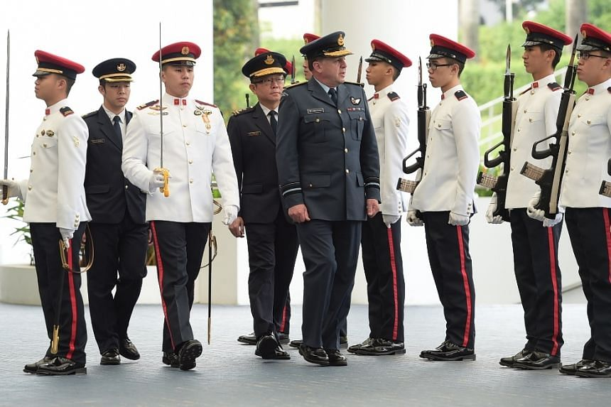 AVM Yardley inspecting a Guard of Honour at MINDEF.