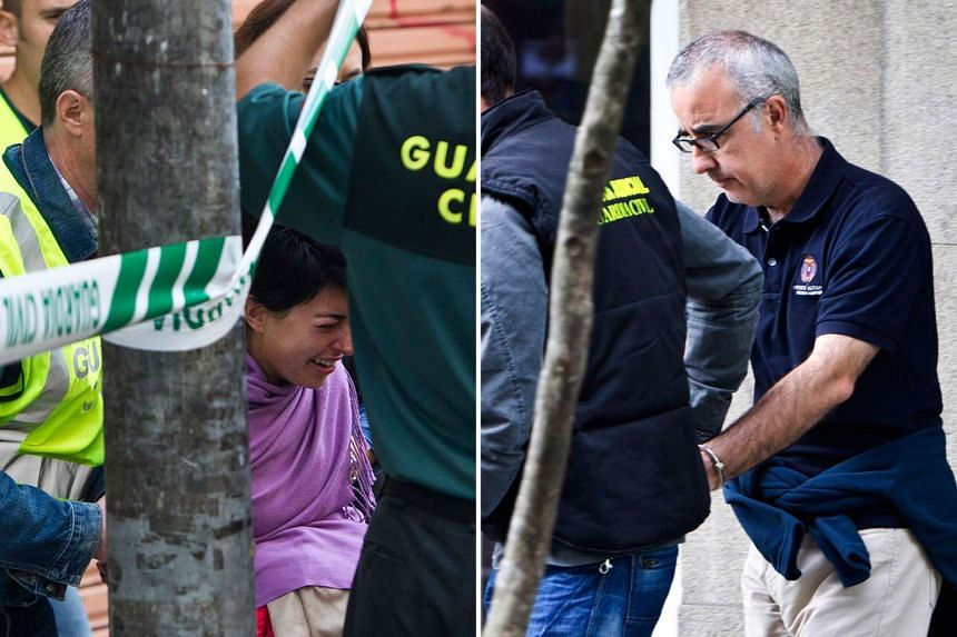 Accused Rosario Porto (left) and her ex-husband Alfonso Basterra being escorted by Spain's Guardia Civil on Sept 26, 2013, during a search of their home.