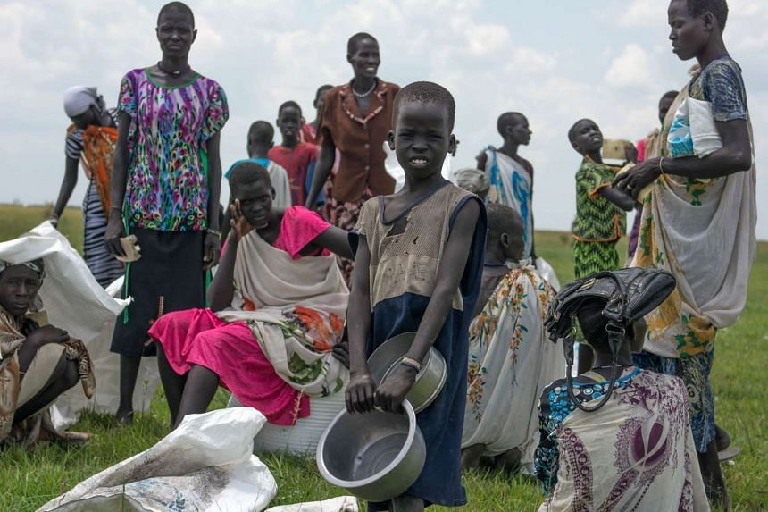 Displaced women and children waiting for their food rations after an humanitarian air drop by the World Food Programme in South Sudan on July 25.