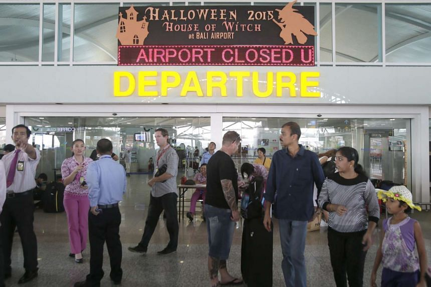 Passengers wait for their delayed fligths at Bali's Ngurah Rai International Airport in Bali, Indonesia on Nov 4, 2015.