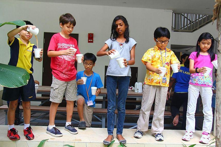 (From left) Tobias Tan, Aidan Hudson, Samuel Ng, Kyosha Pillai, Zaccheus Poh and Celestine Tan learning to make tea during a KidsAccomplish session on Sri Lanka.