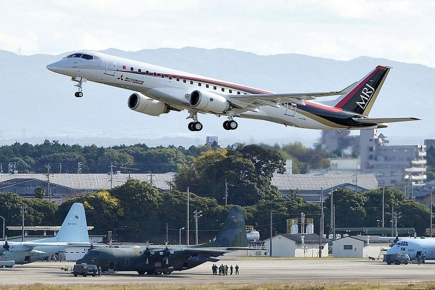 The Mitsubishi Regional Jet, painted with dark blue, red and beige stripes, took off from Nagoya airport under clear skies for a 90-minute test trip yesterday.