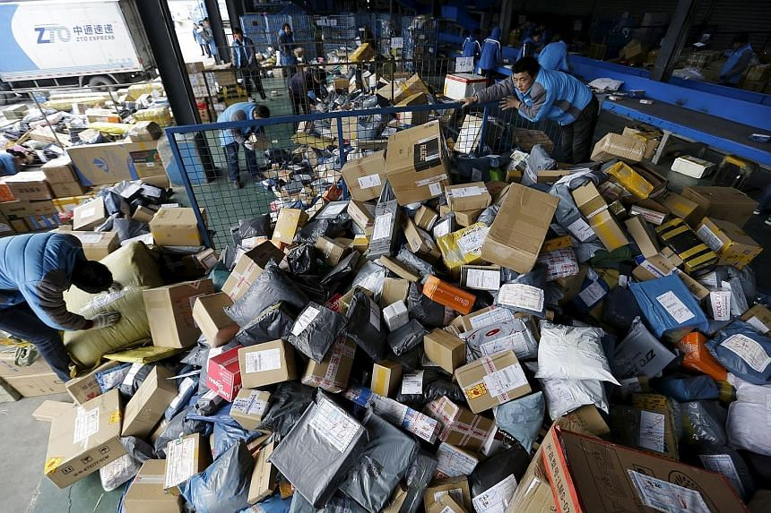Employees at a sorting centre of Zhongtong Express ahead of Singles Day in Chaoyang District, Beijing, on Sunday.