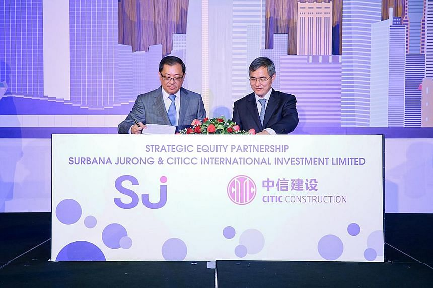 Surbana Jurong group chief executive Wong Heang Fine (left) with Mr Xu Ming Guang, assistant president of Citic Construction and director of CITICC (Africa), yesterday at Surbana Jurong's brand launch. Surbana is investing $85.4 million to get 20 per