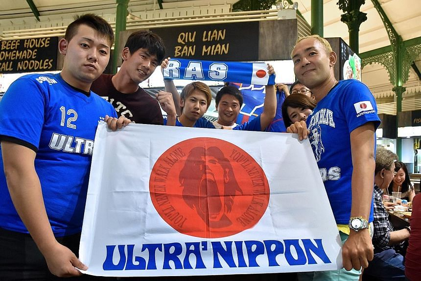 A group of Samurai Blue loyalists display the colours of Ultra Nippon, the committed group of fans who travel the world to support the Japanese national team.