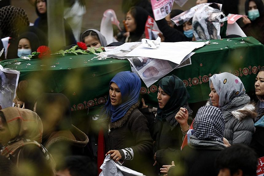 Protesters carrying the coffin of a slain Shi'ite Hazara in Kabul yesterday. The victims were believed to have been held hostage by gunmen for months. Their bodies were found last Saturday.