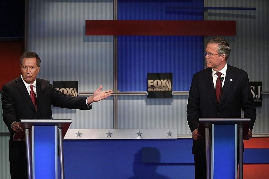 Republican presidential candidates Jeb Bush (right) and John R. Kasich at the Republican Presidential Debate on Tuesday in Milwaukee, Wisconsin. They presented themselves as experienced chief executives with practical solutions to deal with national
