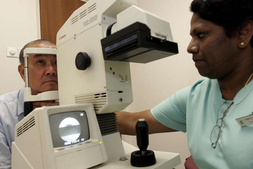 A retiree getting his eyes checked at the SGH Diabetes Centre.