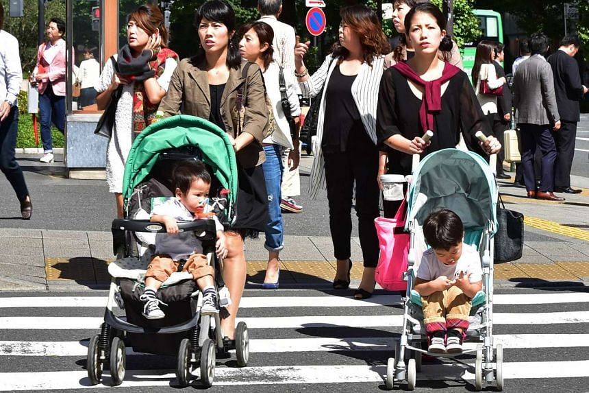 Japanese women pushing baby strollers in Tokyo on Oct 2, 2015.
