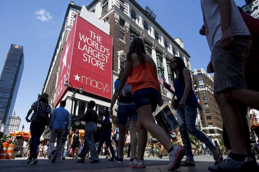 Pedestrians walking past a Macy's department store in New York on Aug 10.