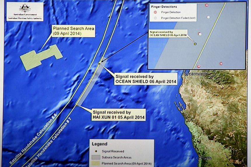Graphics on a TV screen shows the current search area for the missing Malaysia Airlines flight MH370 in this Apr 9, 2014 file photo.