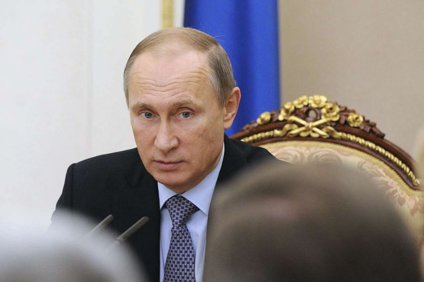 Putin (above) said Russia needed to cooperate with international organisations as openly as it could.