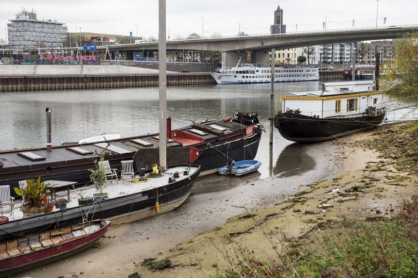 Houseboats lay dry on the Rhine in Arnhem, the Netherlands, on Nov 11, 2015.