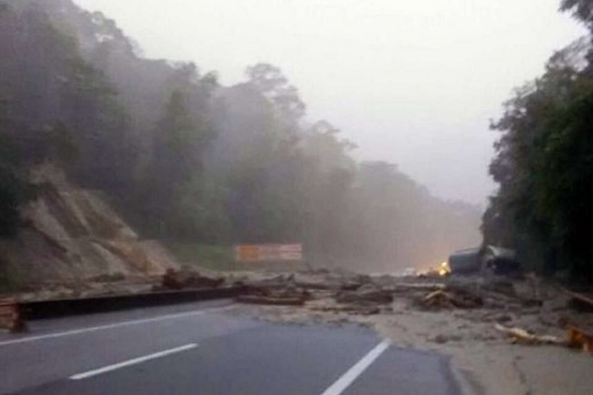 The landslide is blocking all lanes in both directions on the Karak Highway.