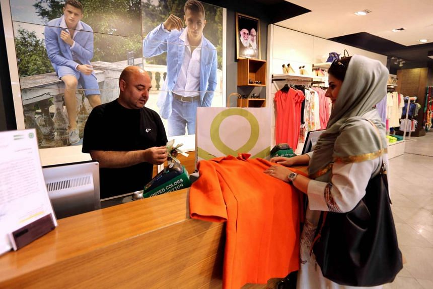 An Iranian woman shopping for clothes at a Benetton store in the capital, Teheran.