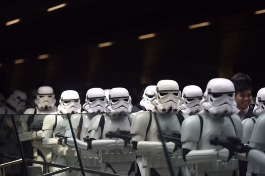 Stormtroopers marching through Changi Airport on Thursday (Nov 12) to celebrate the launch of the Star Wars X-Wing and TIE Fighter displays at T2 and T3.