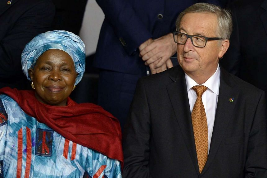 African Union Commission chairman Nkosazana Dlamini-Zuma (left) poses with European Commission president Jean-Claude Juncker on Nov 11, 2015 in Malta.