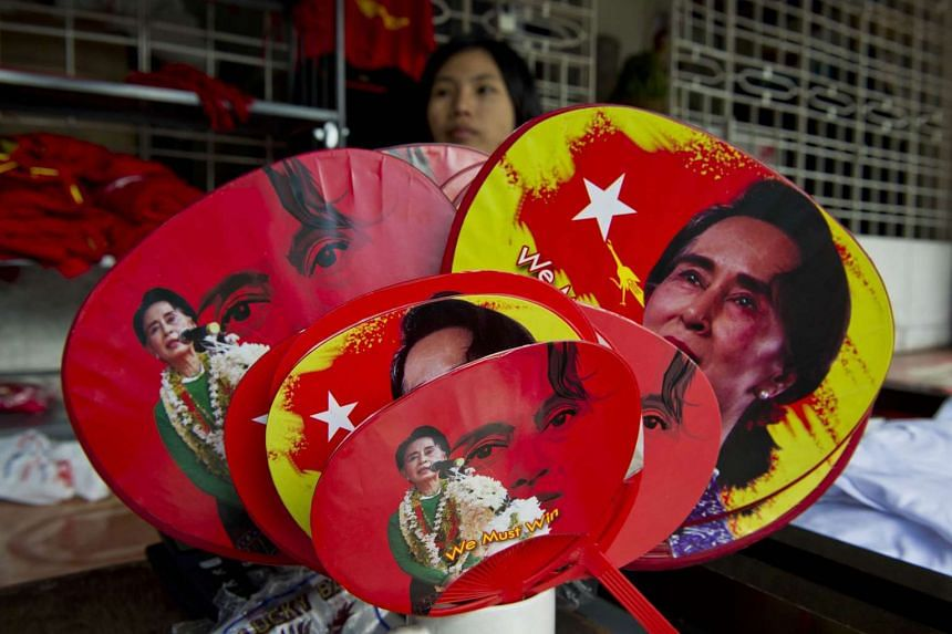 Fans featuring Aung San Suu Kyi for sale at NLD party headquarters in Yangon.