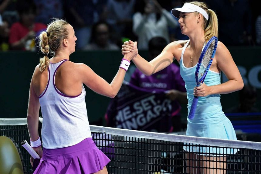 Czech Republic's Petra Kvitova (L) is congratulated by Russia's Maria Sharapova (R) after her win in their women's singles semi-finals match at the WTA Finals in Singapore.