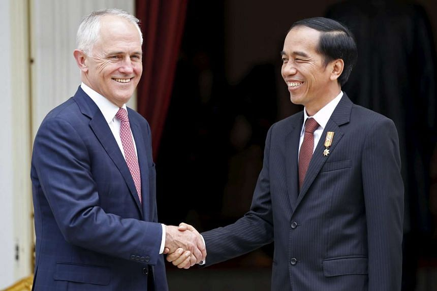 Australian Prime Minister Malcolm Turnbull (left) shakes hands with Indonesian President Joko Widodo at the presidential palace in Jakarta, Indonesia on Nov 12, 2015.