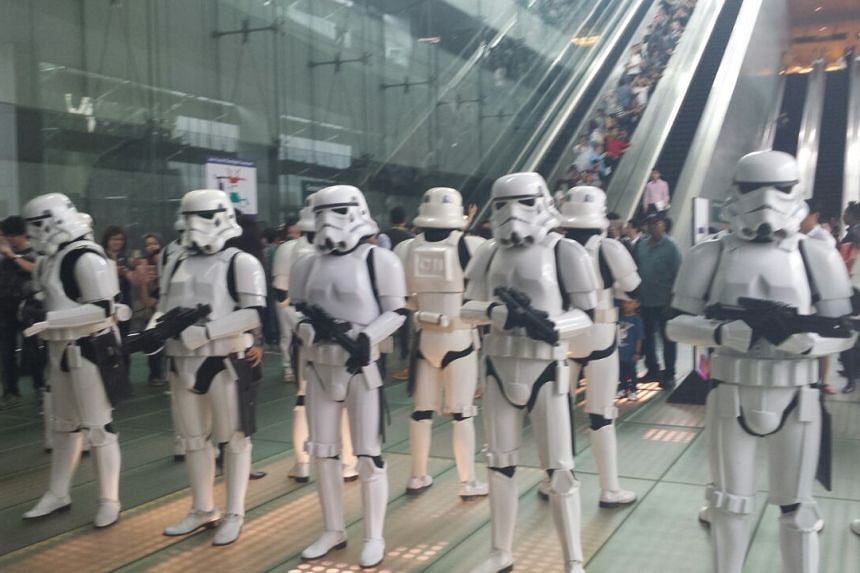Stormtroopers (in white) and Starfighter pilots marching through Changi Airport on Thursday (Nov 12) to celebrate the launch of the Star Wars X-Wing and TIE Fighter displays at T2 and T3.