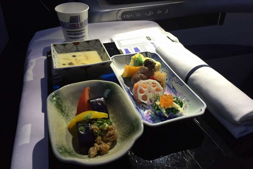 Meals on the ANA Star Wars plane feature R2-D2 napkins and cups.