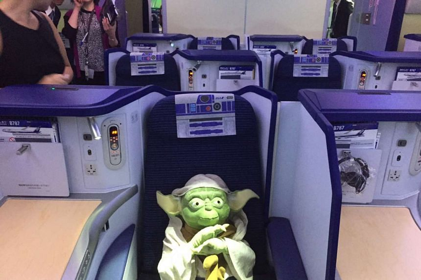 A Yoda soft toy seen on the ANA Star Wars plane.